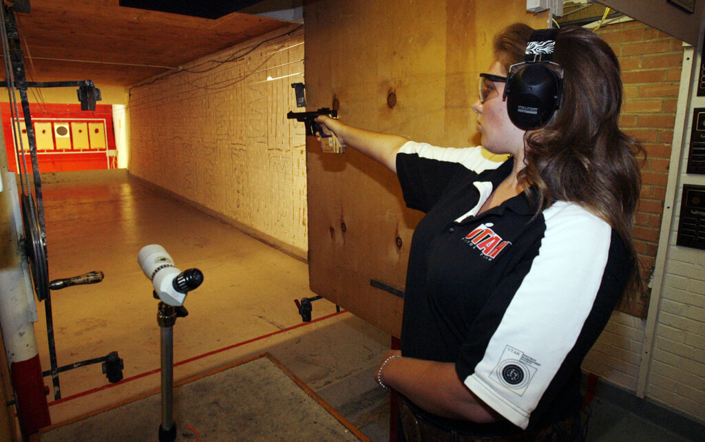 Alexis Lagan trains with a 22 cal Walther GSP pistol in Salt Lake City, Monday, Aug. 20, 2012