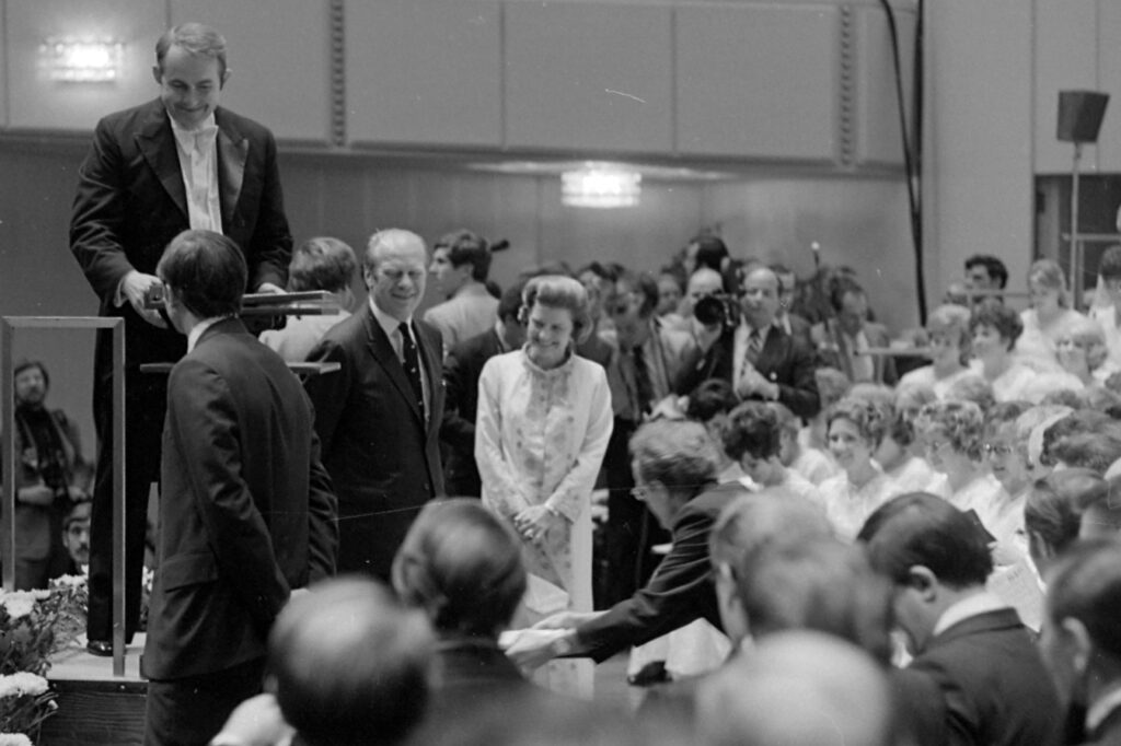 President Gerald R. Ford and first lady Betty Ford joke with the Tabernacle Choir after a performance at the Kennedy Center in Washington, D.C., in September 1974.