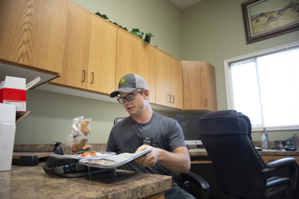 Elder Garrett Mill has lunch during a shift break on Saturday, July 18, 2020, at Idaho Falls Crops, a welfare farm of The Church of Jesus Christ of Latter-day Saints south of Idaho Falls, Idaho.