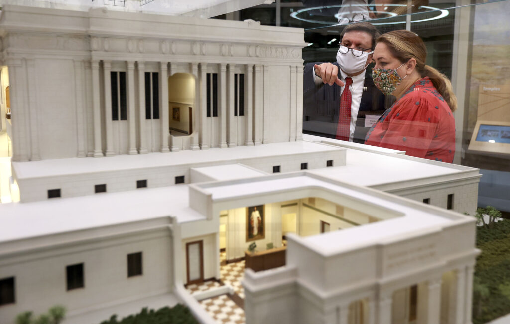 C.W. Ross and Amy Ross look at a model of the Mesa Arizona Temple in the Mesa Arizona Temple Visitors' Center in Mesa, Ariz., on Thursday, Aug. 12, 2021.