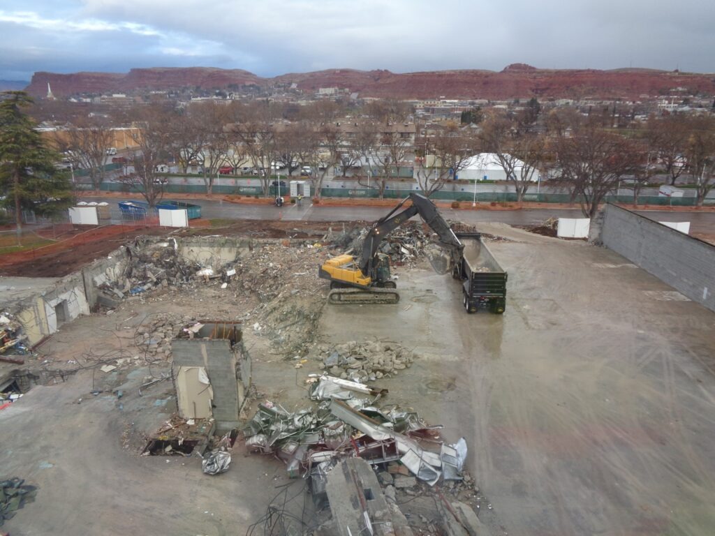 A track hoe loads semi trucks with salvaged debris from the St. George Utah Temple renovation on Jan. 20, 2020. The materials are sorted into piles and then loaded and hauled to recycling plants. Sustainability and recycling are a high priority during the project, which is projected to be completed in 2022.