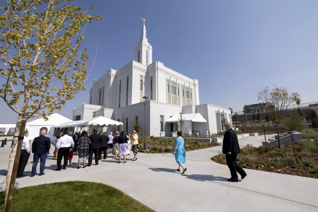 Tour guides attend a meeting as they prepare for the open house at the Pocatello Idaho Temple on Monday, Sept. 13, 2021.