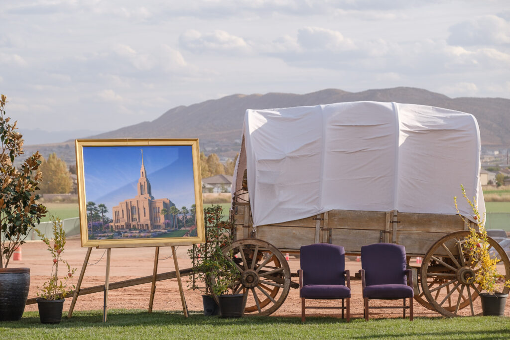 A covered wagon and a rendering of the Red Cliffs Utah Temple of The Church of Jesus Christ of Latter-day Saints is seen prior to the groundbreaking service for the temple in St. George, Utah, Saturday, Nov. 7, 2020.