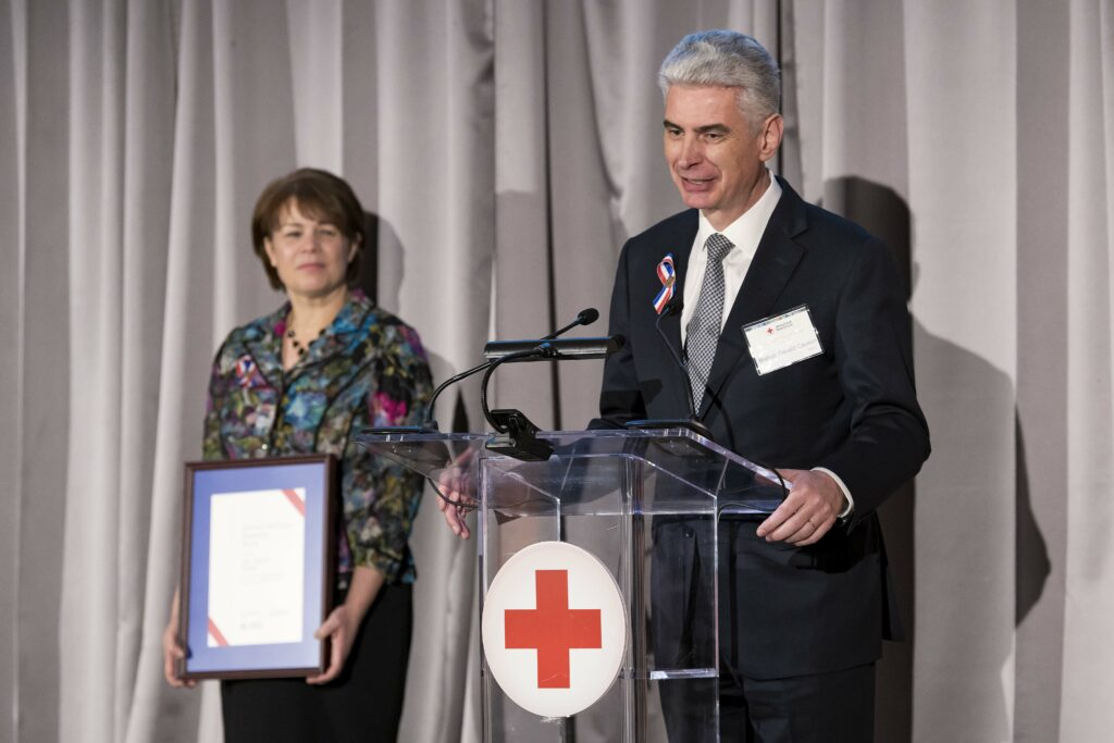 Presiding Bishop Gérald Caussé and Sister Sharon Eubank accept on behalf of Latter-day Saint Charities the American Red Cross Partnership Award at the organization's annual leadership awards dinner in Washington D.C. on March 4, 2020.