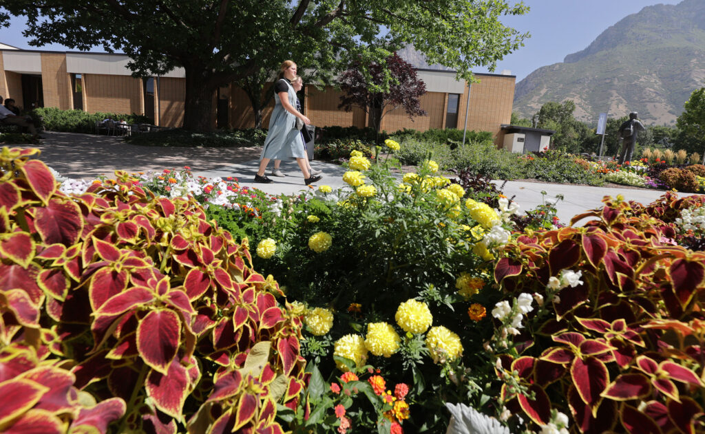 Missionaries walk between class at the Provo Missionary Training Center in Provo, Utah, on Wednesday, Aug 25, 2021.