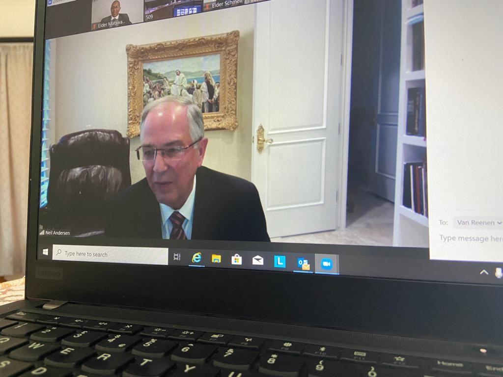 Elder Neil L. Andersen of the Quorum of the Twelve Apostles is shown on a monitor teaching during a videoconference session of a multistake conference session with leaders and members in South Africa and Botswana in November 2020.
