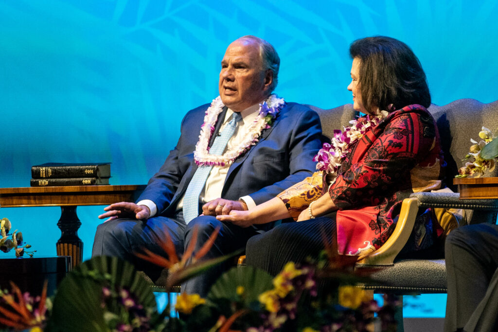 Elder Ronald A. Rasband of the Quorum of the Twelve Apostles, left, speaks and Sister Melanie T. Rasband, right, listens during the young adult devotional for Pacific and Asia areas at the Salt Lake Tabernacle on Temple Square on Saturday, March 13, 2021.