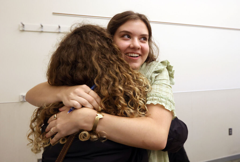 Sister Elizabeth Wheatley hugs her companion, Sister Audrey Morgenegg, as she arrives at the Provo Missionary Training Center and they meet for the first time in person in Provo on Wednesday, Aug. 18, 2021.