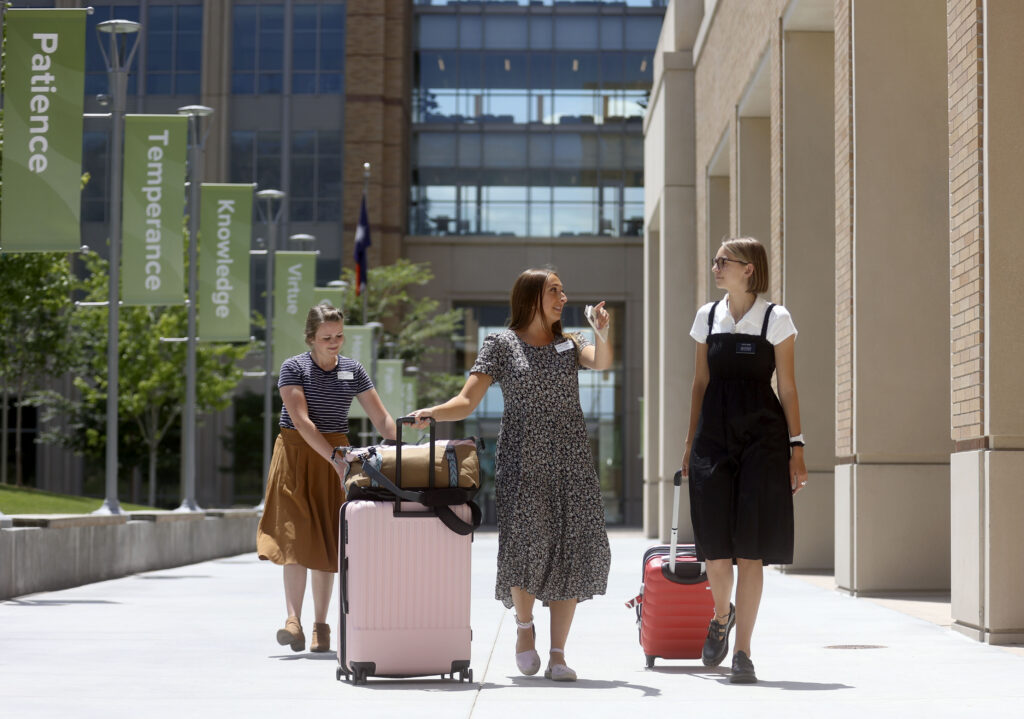 Jessica Chandler and Elizabeth Trommlitz help Sister Adelyne Ward with her luggage as she arrives at the Provo Missionary Training Center in Provo on Wednesday, June 23, 2021.