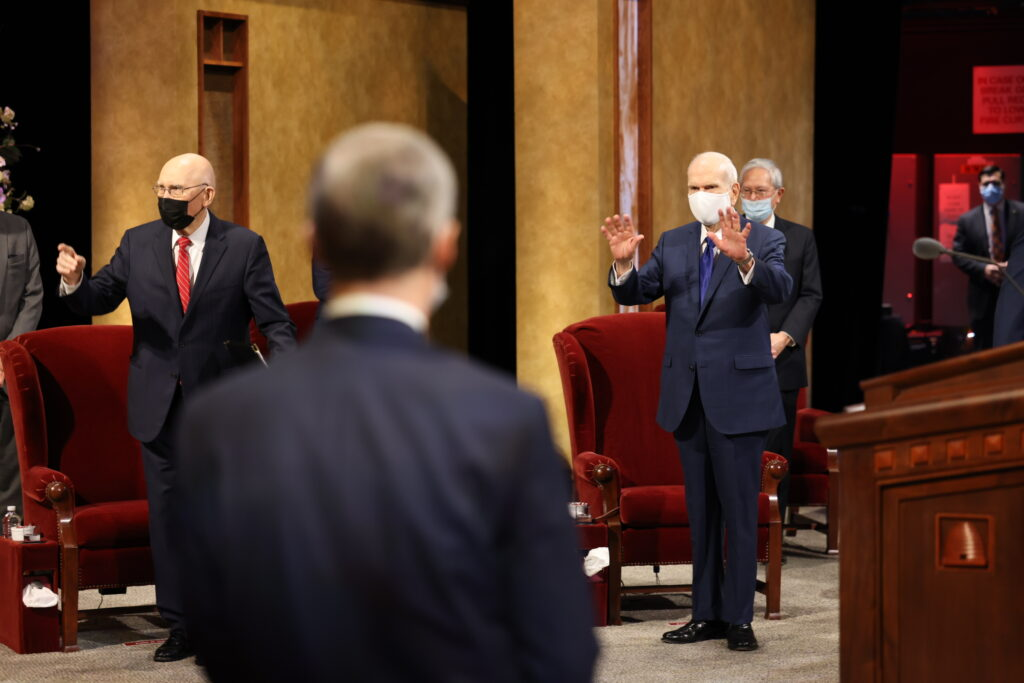 President Russell M. Nelson waves to members of the Quorum of the Twelve Apostles in the Conference Center Theater in Salt Lake City before the Sunday afternoon session of the 191st Annual General Conference of The Church of Jesus Christ of Latter-day Saints on April 4, 2021.