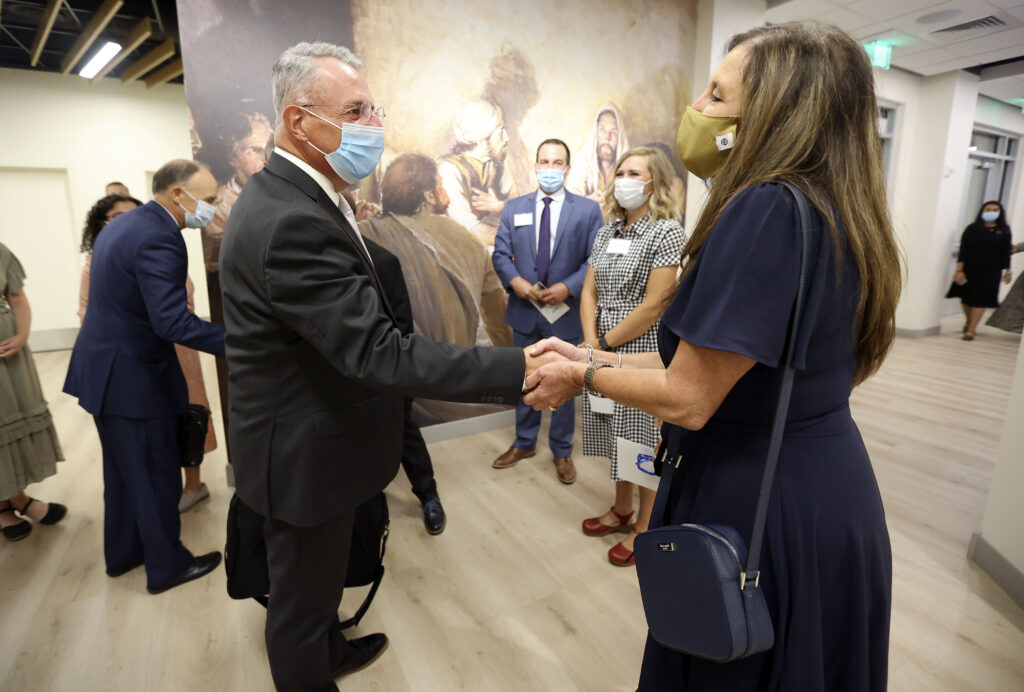 Elder Ulisses Soares of the Quorum of the Twelve Apostles shakes attendees' hands after the dedication ceremony for the Mesa Arizona Temple Visitors' Center in Mesa, Ariz., on Thursday, Aug. 12, 2021.