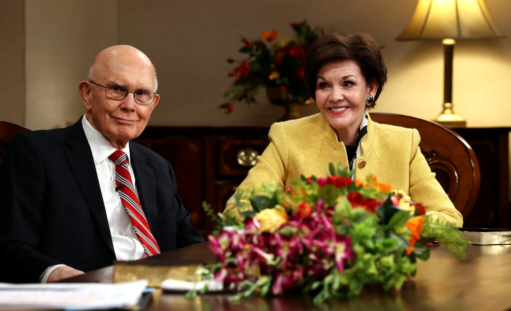 President Dallin H. Oaks of the First Presidency of The Church of Jesus Christ of Latter-day Saints and his wife, Sister Kristen Oaks, listen as they join Elder D. Todd Christofferson of the Quorum of the Twelve Apostles and his wife, Sister Kathy Christofferson, in a conversation while recording a March 14 Spanish-language young adult devotional that was taped at the Church Office Building in Salt Lake City on Friday, Feb. 26, 2021.