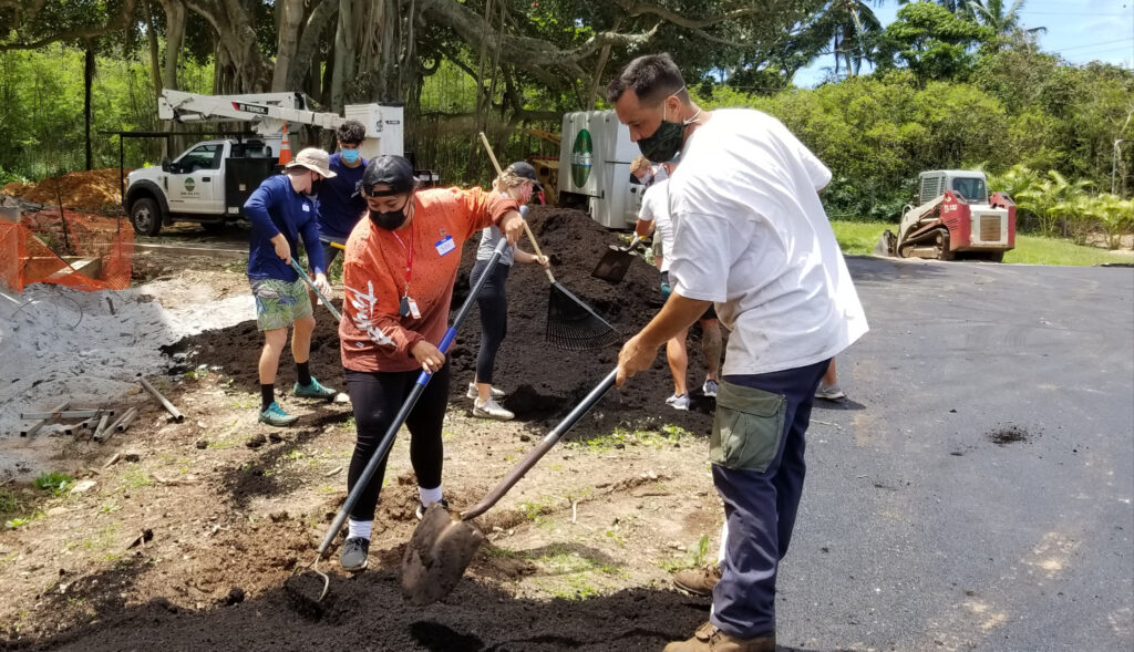 Latter-day Saint volunteers join the landscape crew on the Bromley Family Pearl Haven Campus in Hawaii on March 31, 2021.