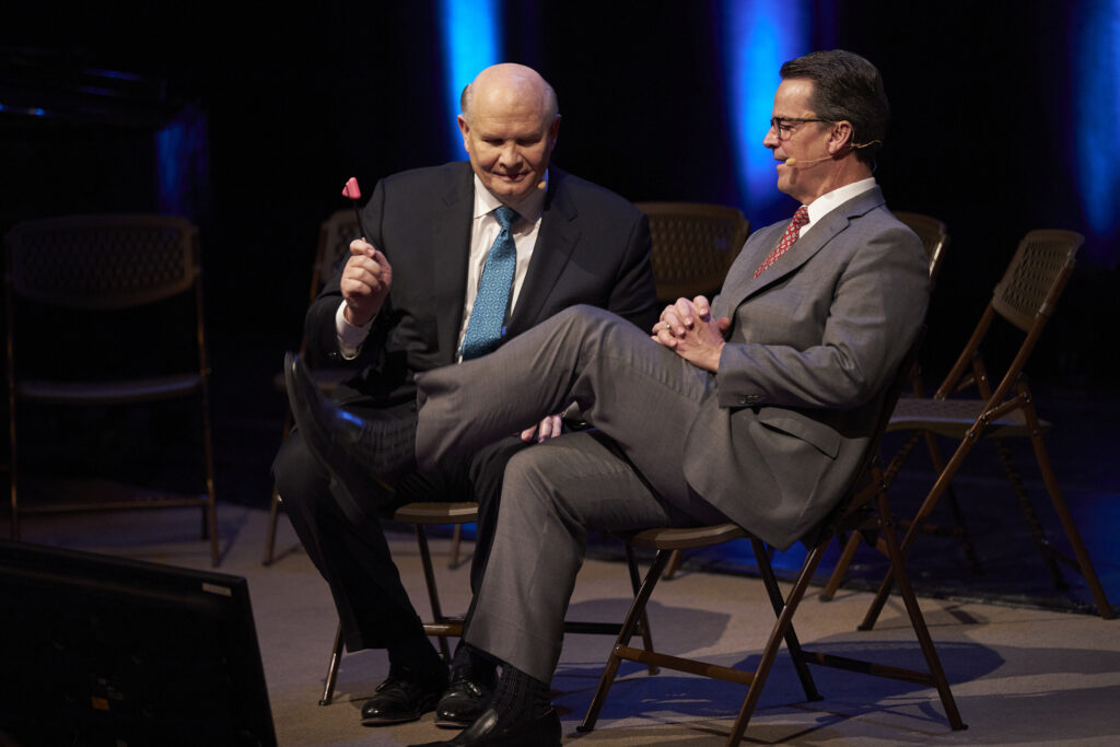 Elder Dale G. Renlund, left, uses a reflex hammer on Elder Shayne M. Bowen in a demonstrationat the 2020 Temple and Family History Leadership Instruction meeting Thursday, Feb., 27, 2020, at the Conference Center Theater in Salt Lake City, Utah.
