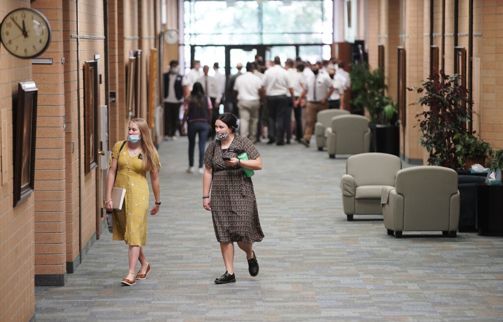 Missionaries walk from lunch at the Provo Missionary Training Center in Provo, Utah, on Wednesday, Aug 25, 2021.