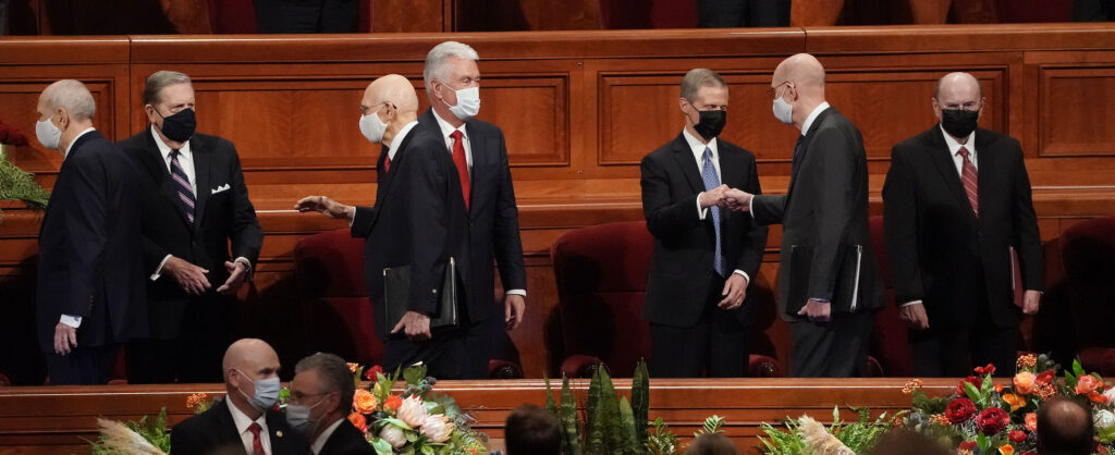 General authorities of The Church of Jesus Christ of Latter-day Saints greet each other during the Saturday afternoon session of the 191st Semiannual General Conference at the Conference Center in Salt Lake City on Saturday, Oct. 2, 2021.