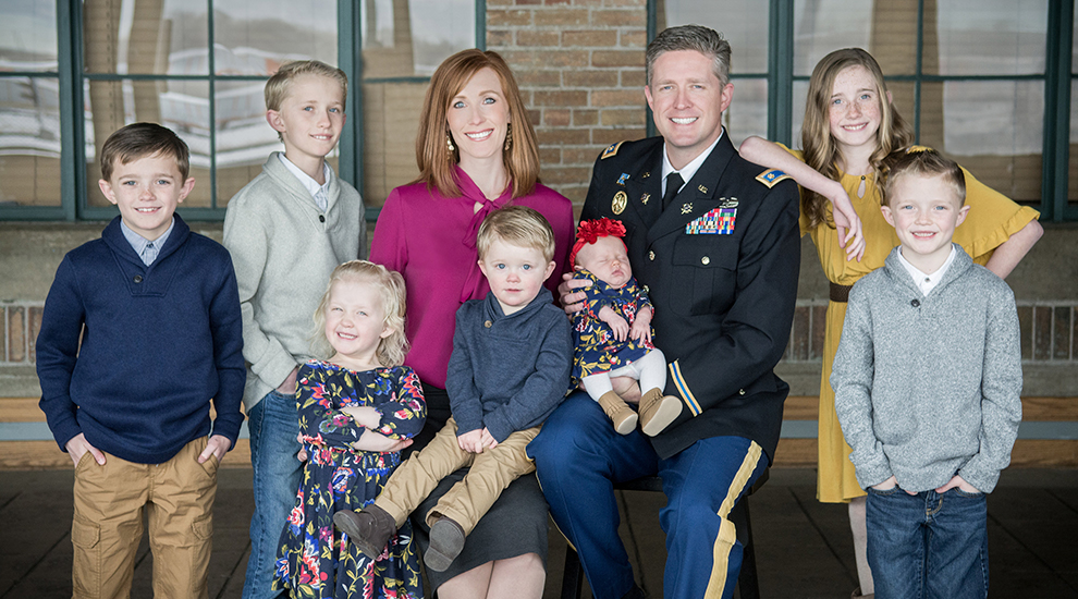 Maj. Brent Taylor and Jennie Taylor along with their seven children before he was deployed in January 2018.